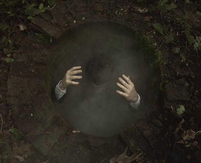 This one required no manipulation. It's a 15 foot manhole - he dropped a smoke bomb in and wedged his feet to the sides.