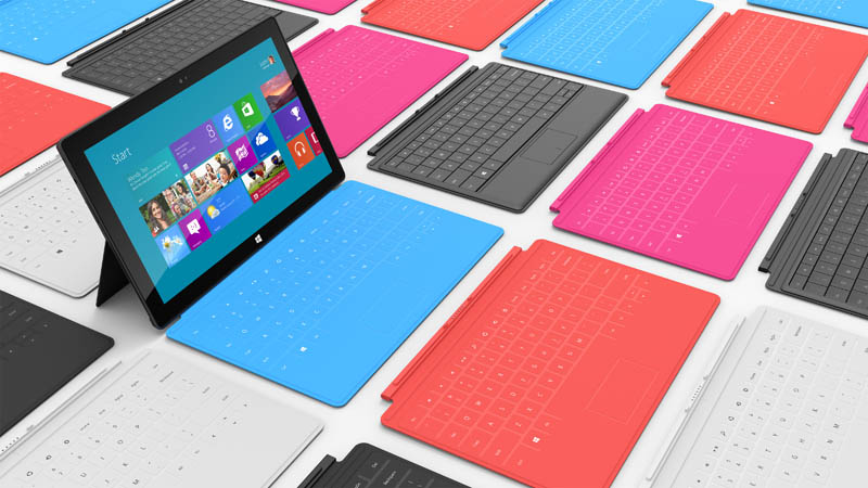 microsoft surface tablet surrounded by colorful keyboards